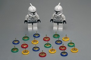 Lego figures with drawing pins obstacle
