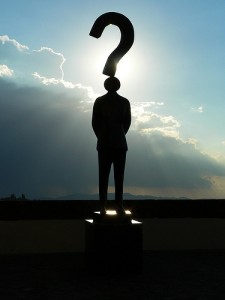 Statue of a man with question mark on his head
