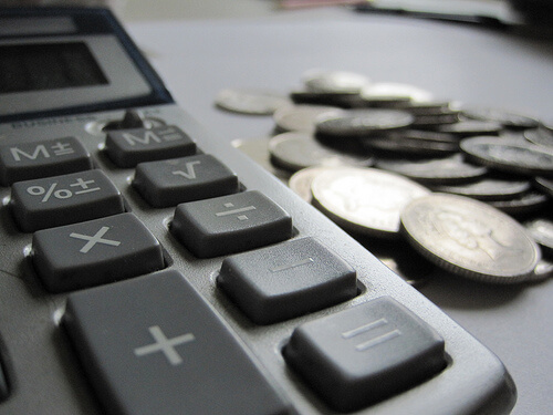 Calculator and pile of loose coins