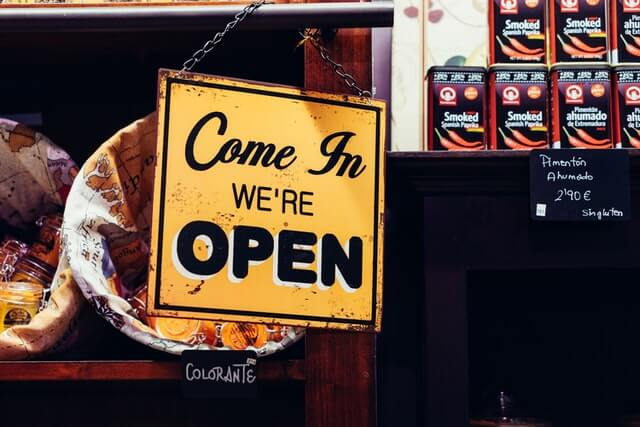Open sign in shop. Difference between a business owner's policy  and general liability insurance